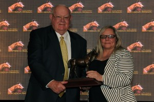 Toronto Ont.April 11, 2014.Woodbine Racetrack.Jockey Club of Canada Sovereign Awards.Outstanding Broodmare Captivating.(L)owner William Graham,(R)CTHS Julie Coulter. michael burns photo