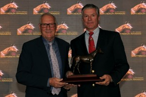 Trainer Roger Attfield (left) accepts the Sovereign Award for Forte Dei Marmi (GB) for owner Stella Perdomo from presenter Jeff Begg, a Jockey Club of Canada Steward