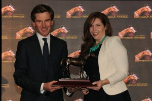 Kathryn Sullivan, Assistant Trainer for Mark Casse accepts the Outstanding Owner John C. Oxley.  The award was presented by Nick Eaves, CEO of Woodbine Entertainment Group