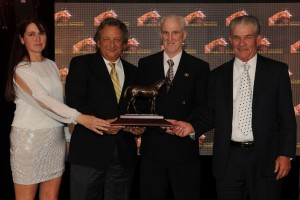 Owner Eugene Melnyk (second from left) accepts the award for Leigh Court, Champion Three-Year-Old Filly from presenter Tom Cosgrove (second from left), Woodbine Racetrack Archivist