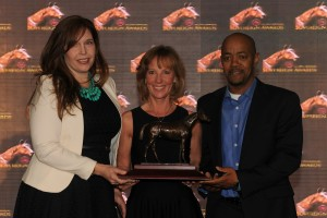 Kathryn Sullivan (left) and David Adams (right), Assistant Trainers for Mark Casse, accept the Sovereign Award for Oustanding Trainer on behalf of Mark Casse.  The trophy was presented by Yvonne Schwabe, CTHS of Ontario Director and Member of the Jockey Club of Canada