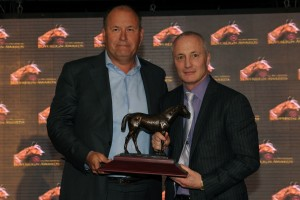 Toronto Ont.April 11, 2014.Woodbine Racetrack.Jockey Club of Canada Sovereign Awards.Outstanding Breeder Sam Son Farms,Rick Balaz(L) presenter(R) Glenn Sikura(Ont Div CTHS) michael burns photo