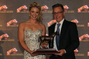 Apprentice Jockey Skye Chernetz accepts the Sovreign Award for Outstanding Apprentice Jockey from Robert King, Manager of the Jockeys' Benefit Association of Canada