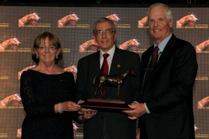 Susan (left) and Jim Hill (right) accept the Sovereign Award for Solid Appeal, Champion Turf Female from presenter Charles Overland (center) a Jockey Club of Canada Steward