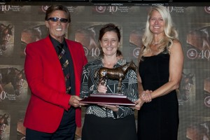 Conquest Stables Ernie Semersky and Dory Newell (right) accept the award for Two Year Old Filly Conquest Harlanate from Jockey Club of Canada Executive Director Stacie Roberts