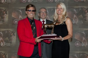 Ernie Semersky (left) and Dory Newell  of Conquest Stables accept the Two Year Old Male award for Conquest Typhoon from Jockey Club of Canada Steward Charles Overland