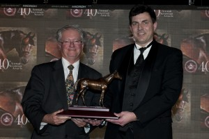 Dave Briggs (right) accepts the Sovereign for Outstanding Writing from John Stapleton, President of the Canadian Horse Racing Hall of Fame