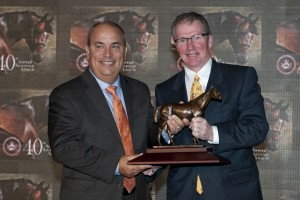 On behalf of Owner, John C. Oxley, Trainer Mark Casse (left) accepts the award for Dynamic Sky, Champion Turf Male, from Jockey Club of Canada Steward Geordie Hendrie