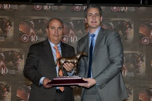 John C. Oxley was named Outstanding Owner of 2014 and trainer Mark Casse (left) accepts the award from Woodbine's Director of Marketing, John Siscos