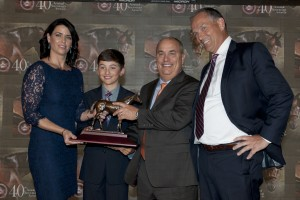 Trainer Mark Casse with his wife Tina and their son Colby accept the Horse of the Year award for Lexie Lou on behalf of owner Gary Barber from Jockey Club of Canada Chief Steward, Jim Lawson