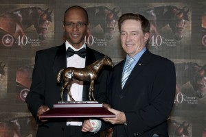 Patrick Husbands (left) accepts his award for Oustanding Jockey from Hall of Fame and Champion Jockey Sandy Hawley