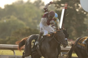 Jockey Jim McAleney celebrates as the Reade Baker Trained, Breaking Lucky, owned by Gunpowder Farms LLC,  crosses the wire a neck ahead of Queen's Plate winner Shaman Ghost in the 80th running of the Prince of Wales Stakes at Fort Erie Racetrack on July 28. Michael Burns Photo