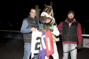 Toronto Ont. November 29,2015.Woodbine Racetrack.Jockey Eurico Da Silva holds 201 saddle cloths after Elijah captures the last race of the 2015 thoroughbred racing season.Eurico Da Silva captures the Jockey's title at Woodbine Racetrack. (L-R) trainer Don McRae,jockey Eurico Da Silva and groom. michael burns photo